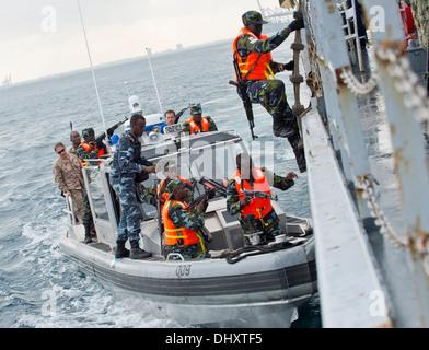 DJIBOUTI, Djibouti (Nov. 14, 2013) - Uganda People's Defence Force members board a target vessel during Exercise - Stock Photo