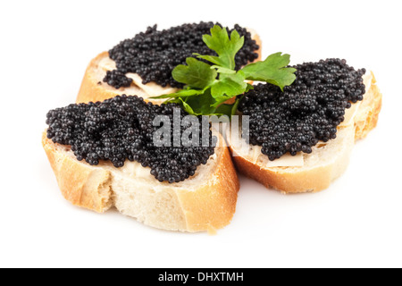 Sandwiches with black caviar isolated on white background - Stock Photo