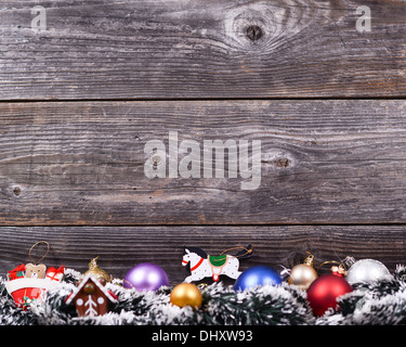Christmas background with various colorful decorations on wooden wall - Stock Photo