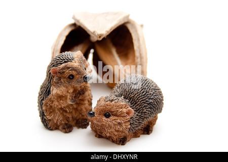 Hedgehog figure with nutshell - Stock Photo