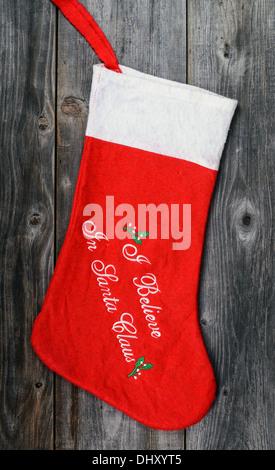 Christmas stocking on wooden background - Stock Photo