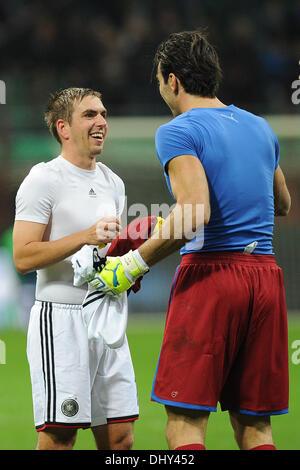 Milan, Italy. 15th Nov, 2013. Germany's Philipp Lahm (L) swaps jerseys with Italy's goalkeeper Gianluigi Buffon - Stock Photo
