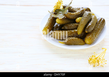 pickled cucumbers on a white plate, food - Stock Photo