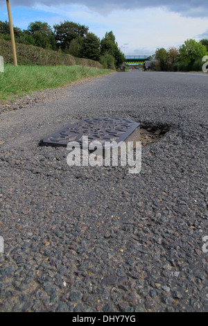 With a recent survey showing that two thirds of UK motorists encounter between one and five potholes every day.Pothole - Stock Photo