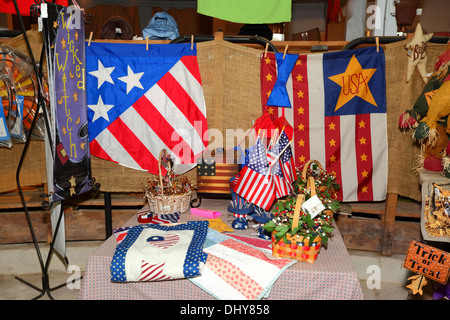 Flags and souvenirs for sale in souvenir shop in the Round Barn, near Gettysburg , Adams County , Pennsylvania , - Stock Photo