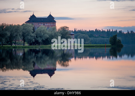 Hämeenlinna Castle nightscene with reflections on water in Finland at night - Stock Photo