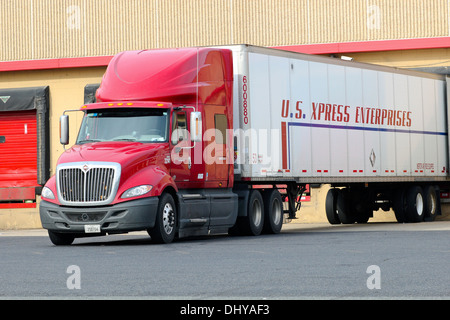 Truck lorry semi tractor trailer backed up to a loading dock. - Stock Photo