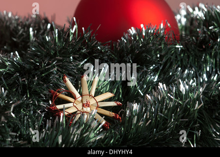 Christmas traditional decoration with straw star - Stock Photo