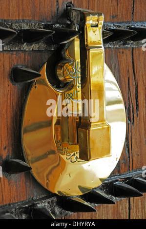 Ornate Brass door knocker, Bastakiya District, Dubai, United Arab Emirates. - Stock Photo