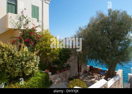 Griechenland, Dodekanes, Insel Chalki, Nimborio, Villa Praxithea am Meer - Stock Photo