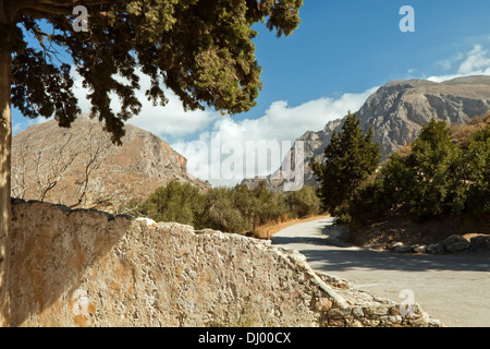 Mountain landscape at Preveli in Crete, Greece. The wall ( left ) is part of the old Venetian Bridge over the river - Stock Photo