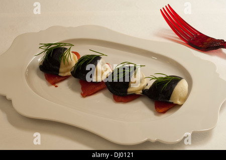 White and black Ravioli of grouper and marjoram in guazzetto - Stock Photo