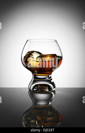 Whiskey in glass with ice - Stock Photo