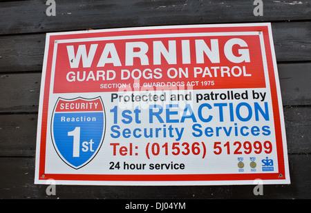 Dog Patrol warning sign reaction force - Stock Photo