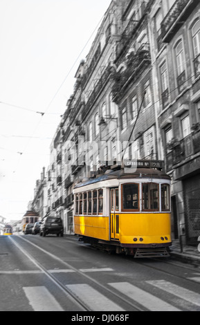 The Number 28 tram in motion blurr, running through Lisbon, Portugal. - Stock Photo