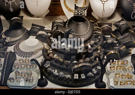 Jewelry displayed in a store window in Antwerp's diamond district - Stock Photo
