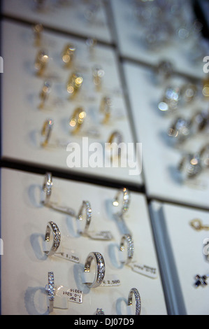 Rings displayed at a store window in Antwerp's diamond district - Stock Photo