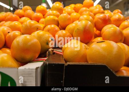 Oranges fruit in supermarket - Stock Photo
