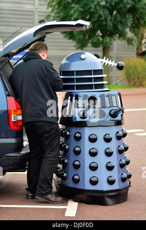 Ray Hyde from Barnsley assembles one of the 20 Daleks displayed at the 'Science of the Timelords' event are assembled - Stock Photo