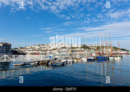 Brixham Devon marina with boats and yachts England Torbay UK under blue sky and white clouds - Stock Photo