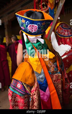 Bhutan, Thimpu Dzong, annual Tsechu, monk musician in colourful embroidered costume - Stock Photo