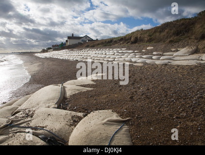 Winter storms have removed shingle and exposed sea defences on the coast at Thorpeness, Suffolk, England, November - Stock Photo