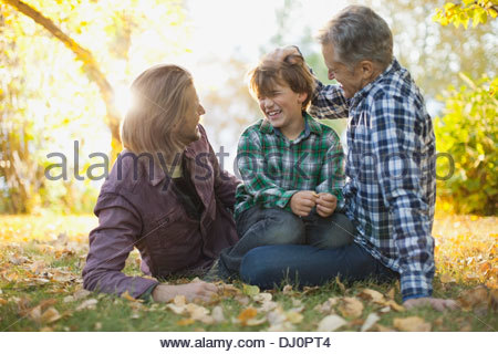 Cheerful three generation males spending leisure time at park - Stock Photo