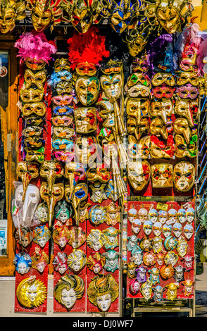 Carnival masks are very popular tourist souvenirs and are displayed in many small shops and street stalls. - Stock Photo