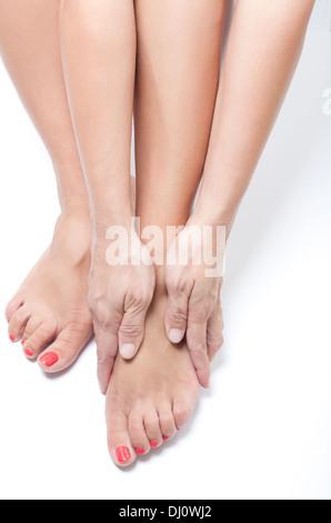 woman massaging feet - Stock Photo