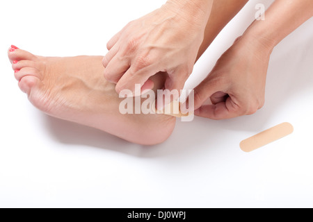woman's foot with patch on ankle - Stock Photo