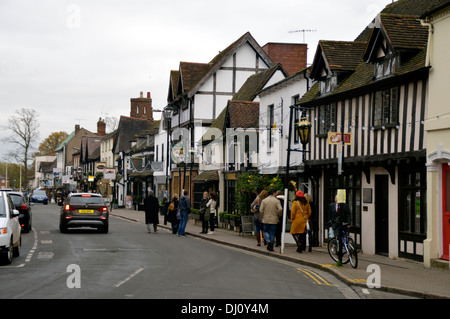 Half timbered buildings on a street in Stratford upon Avon - Stock Photo
