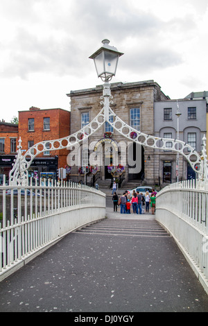 The Ha'penny Bridge Dublin Ireland - Stock Photo