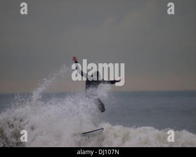 Man falling off surfboard, Croyde Bay, Devon, UK - Stock Photo