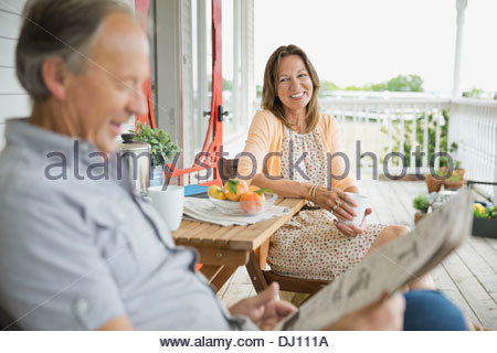 Senior couple spending time together on front porch - Stock Photo