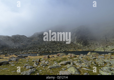 Foggy day in Peñalara, highest mountain peak in the mountain range of Guadarrama, Spain - Stock Photo