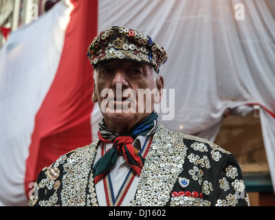 Traditional Pearly King and Pearly Queen in London. - Stock Photo