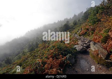 Foggy day in Peñalara, highest mountain peak in the mountain range of Guadarrama, Spain - Stock Photo