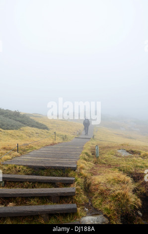 Hiker in Peñalara, highest mountain peak in the mountain range of Guadarrama, Spain - Stock Photo