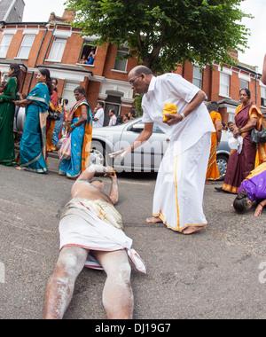 Rolling Pilgrims At The Rath Yatra Hindu Festival from the Murugan Temple North London UK - Stock Photo