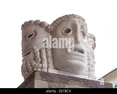 Mask Sculpture at the Festival. A sculpture of 4 masks decorates the entrance to the famous Salzburg Festival. - Stock Photo
