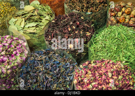 Herbs, flowers and seeds for sale in the Spice Souk; Dubai, United Arab Emirates. - Stock Photo