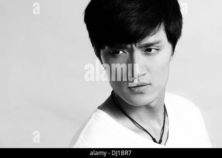 Portrait of handsome young man posing and looking cool, black and white style - Stock Photo