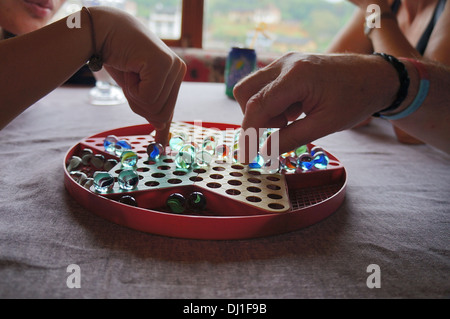 People playing Chinese Checkers - Stock Photo