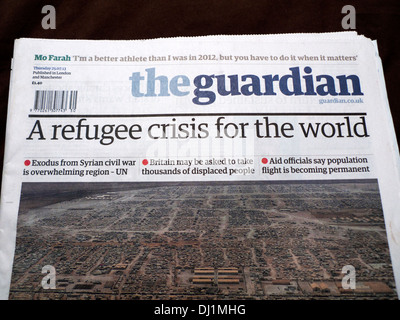 'A refugee crisis for the world' Guardian newspaper headline on front page headline article of paper on Syrian refugees - Stock Photo