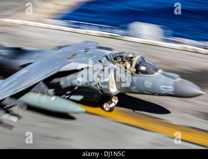 A US Marine AV-8B Harrier fighter aircraft prepares to take off from the flight deck of the USS Kearsarge November - Stock Photo