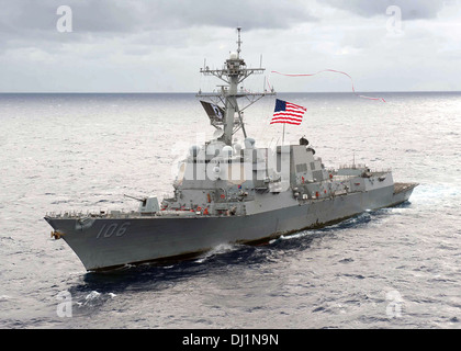US Navy Arleigh Burke-class guided-missile destroyer USS Stockdale hoists a 240-foot homeward bound pennant as it - Stock Photo