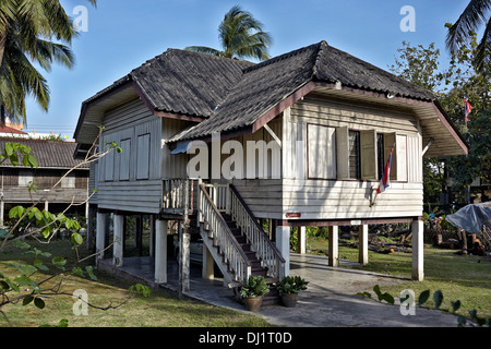 Traditional wooden Thai house elevated on stilts. Thailand S. E. Asia - Stock Photo