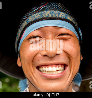 Portrait of a smiling Japanese rickshaw puller, Kyoto, Japan - Stock Photo