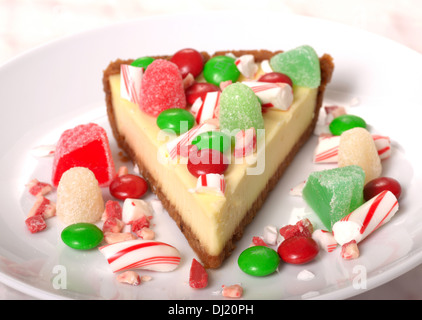 Delicious Festive Christmas Cheesecake with assorted candies - Stock Photo