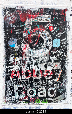 Famous Abbey Road studios sign in London. Visitors have left lot of scribble and signatures. - Stock Photo
